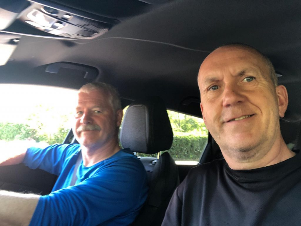 Steve and Paul driving the Admin Vehicle.